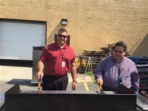 Mr. Zipp and Mr. Marchese Grilling