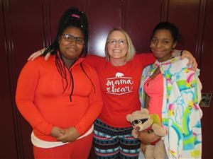 PJ school-wide celebration- Mrs. Moore with students
