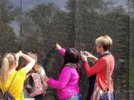 Teacher and students at Vietnam Veterans Memorial Wall