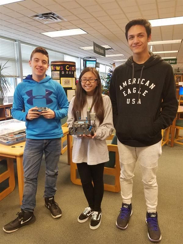 High School Students show off their XEX IQ Robot they put together in the MS/HS Lbrary